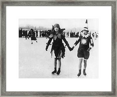 Chinese Flapper Girls Skating Framed Print by Underwood Archives