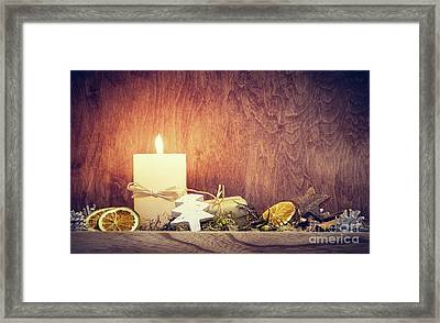 Chistmas Decoration With Candle Glowing On Wooden Wall Background Framed Print by Michal Bednarek