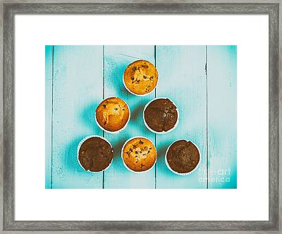 Chocolate Chip Muffins On Blue Table Framed Print by Radu Bercan