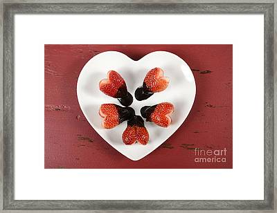 Chocolate Dipped Heart Shaped Strawberries On Heart Shape White Plate Framed Print by Milleflore Images