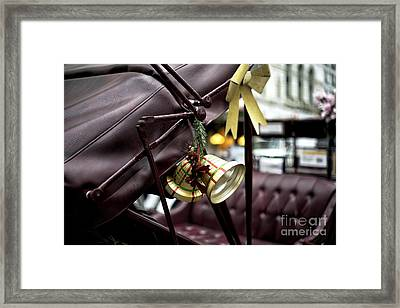 Christmas Bell On The Carriage Framed Print by John Rizzuto
