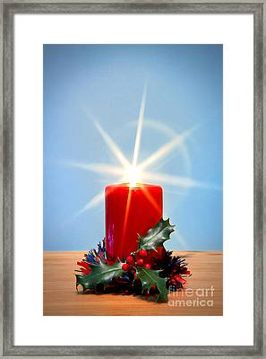 Christmas Candle With Starburst And Holly. Framed Print by Richard Thomas
