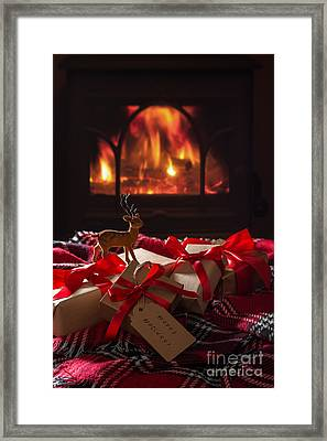 Christmas Gifts By The Fire Framed Print