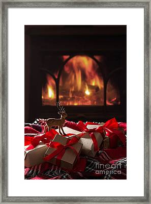 Christmas Gifts By The Fireplace Framed Print