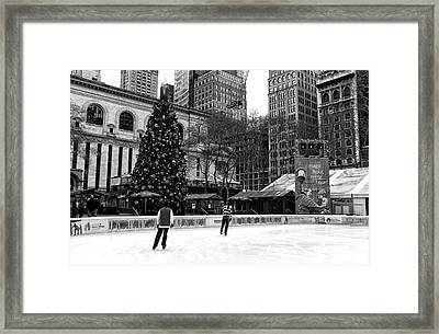 Christmas Ice Skating Framed Print by John Rizzuto