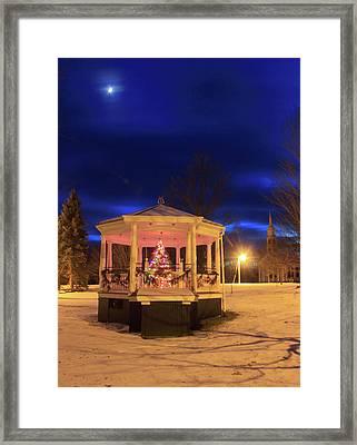 Christmas Moon Over Town Common Framed Print by John Burk