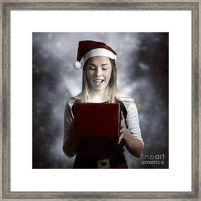 Christmas Present Girl Opening Magic Gift Box Framed Print