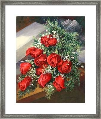 Christmas Red Roses Framed Print by Laurie Hein