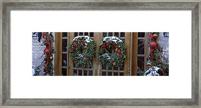 Christmas Wreaths Hanging On Doors Framed Print by Panoramic Images