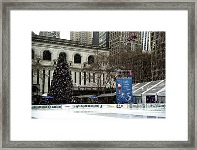 Christmastime In Bryant Park Framed Print by John Rizzuto