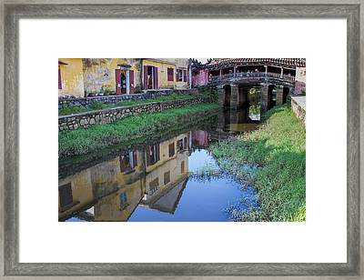 Framed Print featuring the photograph Chua Cau Reflection by Hitendra SINKAR