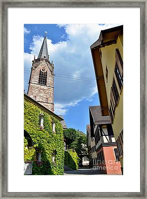 Church Tower Between Houses Framed Print by Elzbieta Fazel