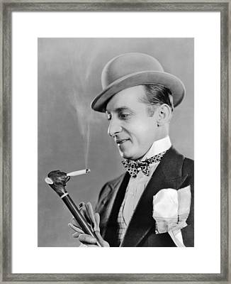 Cigarette Smoking Cane Framed Print by Underwood Archives