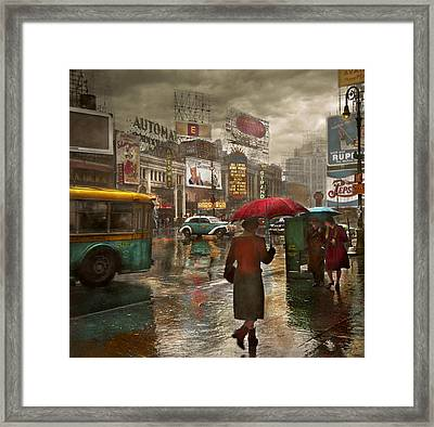 City - Ny - Times Square On A Rainy Day 1943 Framed Print by Mike Savad