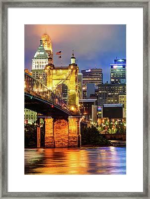 City Of Cincinnati And Roebling Bridge On The River Framed Print