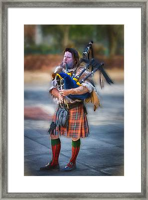 Clan Macintosh Piper Framed Print by John Haldane