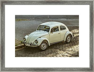 Classic Beetle Car Parked On Street Framed Print by Daniel Ferreira-Leites
