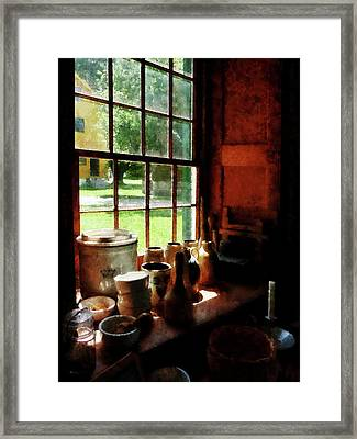 Framed Print featuring the photograph Clay Jars On Windowsill by Susan Savad