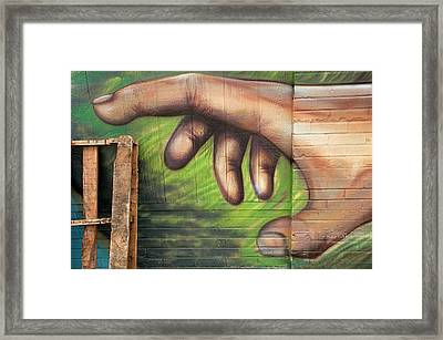 Cleaning Up - Artistic Hand Reaching For A Real-life Skid Framed Print by Mitch Spence