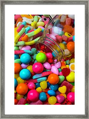Clear Jar Spilling Candy Framed Print by Garry Gay