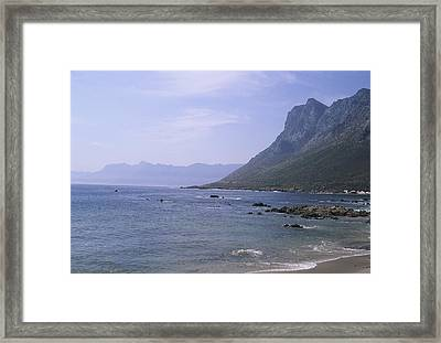 Cliffs Rise From The Ocean Near Cape Framed Print by Stacy Gold