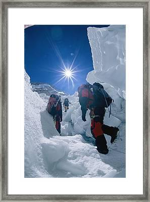 Climbers Ascend The Khumbu Ice Fall Framed Print by Bobby Model