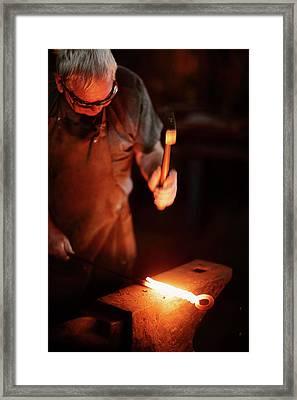 Close-up Of  Blacksmith Forging Hot Iron Framed Print