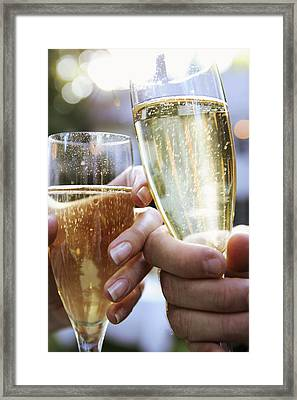 Close-up Of Champagne Flutes Framed Print by Gillham Studios