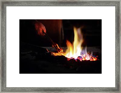 Close-up Of Hand  Heating Iron In Furnace Framed Print