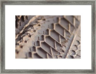 Close Up Of Motorcycle Tread Pattern On Muddy Trail Framed Print