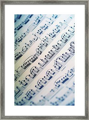 Close-up Of Sheet Music Framed Print by Medioimages/Photodisc