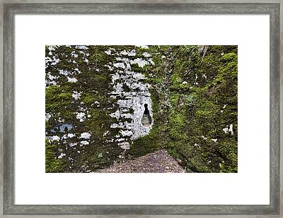 Close View Of A Key Shaped Hole Framed Print by Todd Gipstein