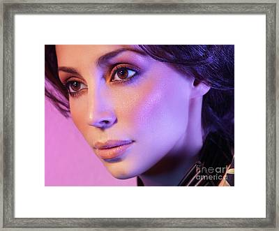 Closeup Beauty Portrait Of Woman Face In Colored Purple Light Framed Print