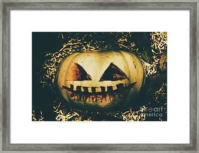 Closeup Of Halloween Pumpkin With Scary Face Framed Print