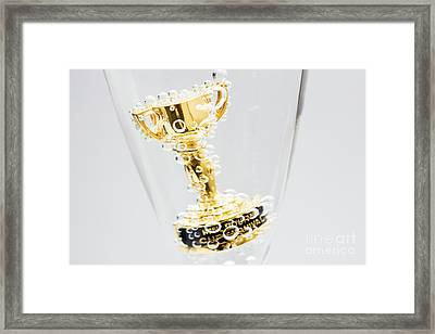 Closeup Of Small Trophy In Champagne Flute. Gold Colored Award I Framed Print by Jorgo Photography - Wall Art Gallery