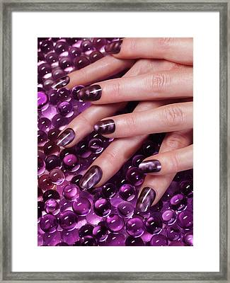 Closeup Of Woman Hands With Purple Nail Polish Framed Print by Oleksiy Maksymenko
