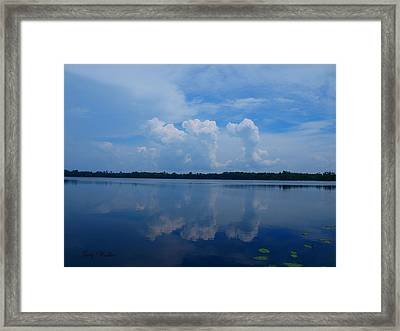 Cloud Reflections Framed Print by Judy  Waller