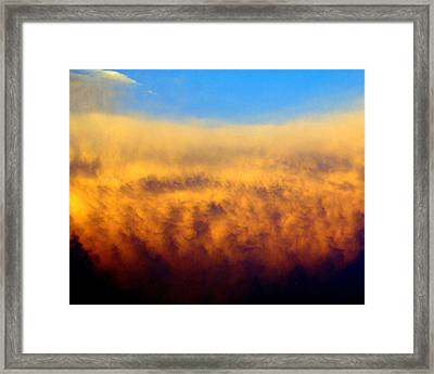Clouds Ablaze Framed Print by Marty Koch