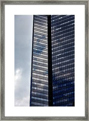 Clouds And Office Building Midtown  Framed Print by Robert Ullmann