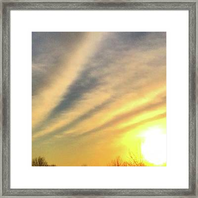 Clouds And Sun Framed Print