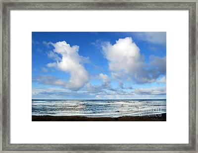 Framed Print featuring the photograph Clouds At Play by Larry Keahey