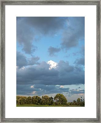 Clouds In A Bright Sky Framed Print