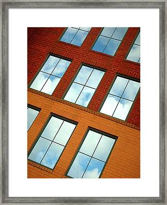 Clouds In The Windows Framed Print