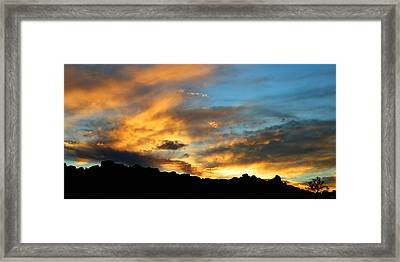 Clouds Of Liquid Gold Framed Print by Glenn McCarthy Art and Photography