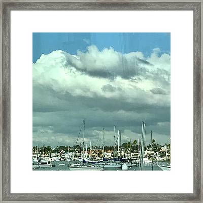 Clouds On The Bay Framed Print by Kim Nelson