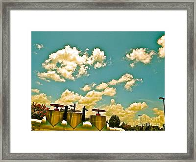 Clouds Over Oil Field Equipent Framed Print by Chuck Taylor