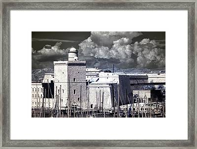 Clouds Over Saint-jean Framed Print by John Rizzuto