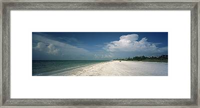 Clouds Over The Beach, Lighthouse Framed Print