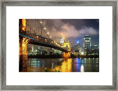 Framed Print featuring the photograph Clouds Over The Cincinnati Skyline - Night Cityscape by Gregory Ballos