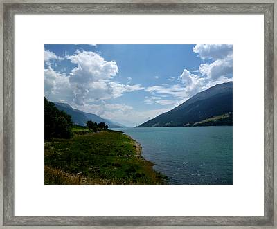 Clouds Over The Lake Framed Print